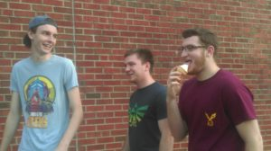 Sophomore member Michael Kern and junior members Ben Wagner and J.T. Henderson stroll past Forrer, Henderson with Caf ice cream in hand.