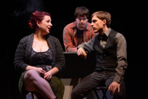 "Del Grosso (right,) Haley Smallwood (left,) and Drew Hauke (center)acting in ""Trust,"" produced by the Theater Department in 2012."