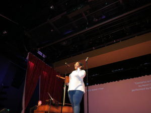Senior Katie Harris introduces her viola piece with accompanist Angela Eaton on piano.