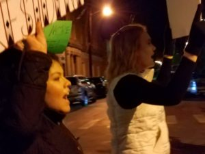 Transy juniors Paola Garcia and Kacy Hines march with demonstrators down Short St.