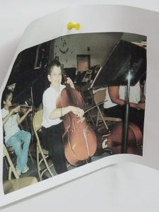 A photo of elementary-school Turner playing cello hangs in Dr. Hawkins' office. He and his parents made a deal that he could return to orchestra after one year trying bassoon, but instead he stayed in band.